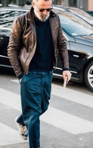 How to Wear Dark Brown Sunglasses For Men: Choose a dark brown leather biker jacket and dark brown sunglasses for a trendy and city casual ensemble. To add more class to your getup, finish with beige athletic shoes.