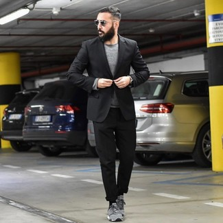 How to wear: grey suede low top sneakers, black chinos, grey crew-neck sweater, black blazer