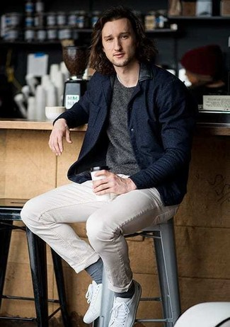 How to wear: white canvas low top sneakers, beige chinos, charcoal crew-neck sweater, navy wool bomber jacket