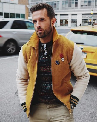How to wear: black sunglasses, beige chinos, navy fair isle crew-neck sweater, mustard wool bomber jacket