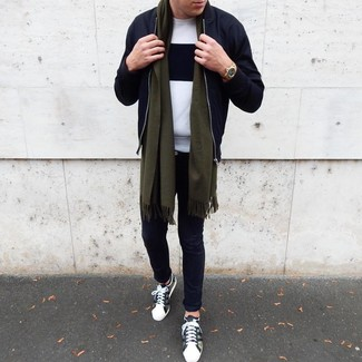 How to wear: olive camouflage low top sneakers, black chinos, white and black crew-neck sweater, black bomber jacket