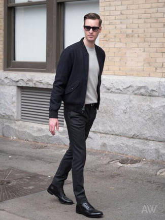 Men's Looks & Outfits: What To Wear In 2020: Rock a navy wool bomber jacket with black chinos to put together an everyday look that's full of style and character. And if you need to easily up the style ante of this outfit with footwear, complete your outfit with a pair of black leather dress boots.