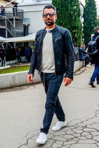 How to Wear White Canvas Low Top Sneakers For Men: This combination of a navy leather bomber jacket and navy chinos is on the casual side yet it's also seriously stylish and seriously sharp. Send this getup in a whole other direction by sporting a pair of white canvas low top sneakers.