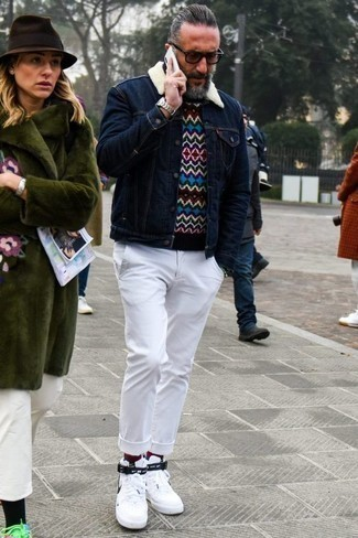 How to Wear a Multi colored Crew-neck Sweater For Men: A multi colored crew-neck sweater and white chinos have become veritable closet styles for most men. White and black canvas high top sneakers are guaranteed to give an air of stylish casualness to this look.