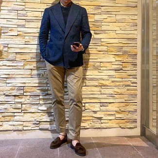 How to wear: dark brown suede tassel loafers, khaki chinos, black crew-neck sweater, navy double breasted blazer