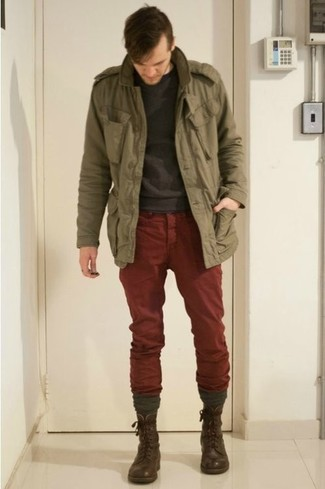 How to wear: dark brown leather casual boots, burgundy chinos, charcoal crew-neck sweater, olive military jacket