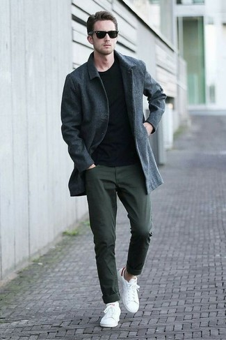 How to wear: white low top sneakers, dark green chinos, black crew-neck sweater, charcoal overcoat