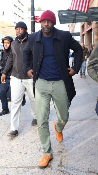 How to wear: tobacco low top sneakers, mint chinos, navy crew-neck sweater, navy overcoat