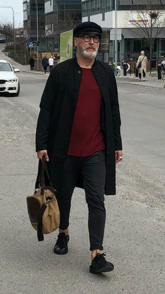 How to wear: black leather low top sneakers, black chinos, burgundy crew-neck sweater, black overcoat