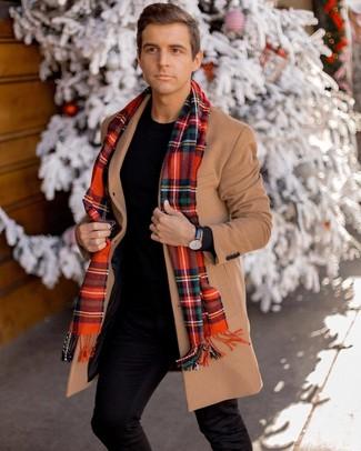 How to wear: red plaid scarf, black chinos, black crew-neck sweater, camel overcoat