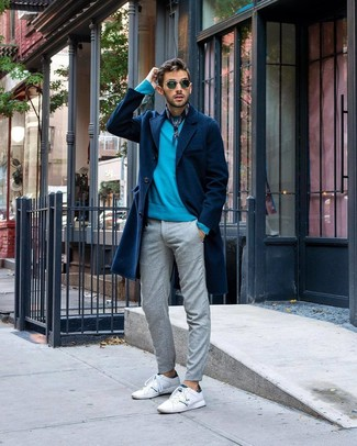How to wear: white leather low top sneakers, grey chinos, aquamarine crew-neck sweater, navy overcoat