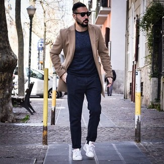How to wear: white leather low top sneakers, navy chinos, navy crew-neck sweater, camel overcoat