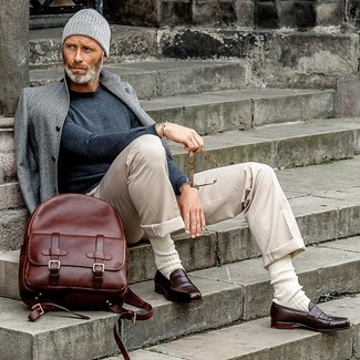 How to wear: dark brown leather loafers, beige chinos, charcoal crew-neck sweater, grey overcoat
