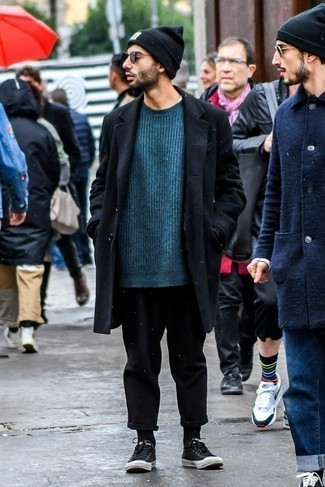 How to Wear a Teal Crew-neck Sweater For Men: The pairing of a teal crew-neck sweater and black chinos makes this a knockout off-duty ensemble. Black low top sneakers are the simplest way to punch up this outfit.