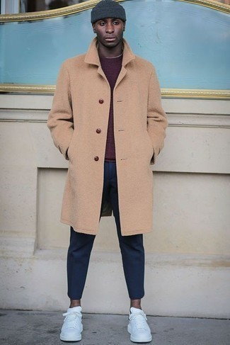 How to Wear Navy Chinos: This combo of a camel overcoat and navy chinos will add manly essence to your outfit. Bring a laid-back feel to by finishing with a pair of white leather low top sneakers.
