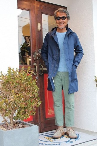 How to wear: beige suede desert boots, mint chinos, light blue crew-neck sweater, navy raincoat