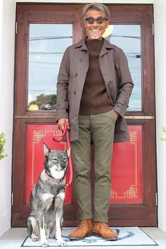 How to wear: tobacco suede work boots, olive chinos, dark brown crew-neck sweater, dark brown raincoat