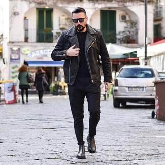 How to wear: black leather chelsea boots, black chinos, black crew-neck sweater, black shearling jacket