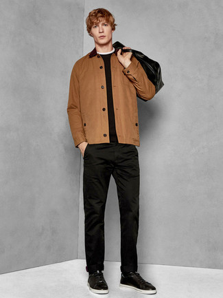 How to wear: black leather low top sneakers, black chinos, black crew-neck sweater, brown shirt jacket