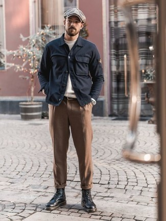 How to Wear a Dark Brown Leather Belt For Men: Nail the effortlessly dapper getup by opting for a navy shirt jacket and a dark brown leather belt. If you want to break out of the mold a little, complement your ensemble with a pair of black leather casual boots.