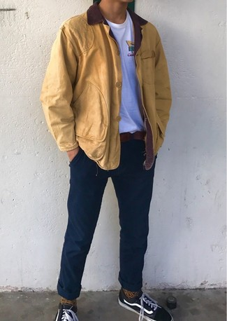 How to wear: black canvas low top sneakers, navy chinos, white crew-neck t-shirt, mustard barn jacket