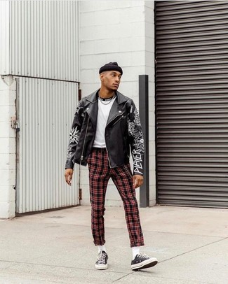 How to Wear Red Plaid Pants In Chill Weather For Men: Nail the casually dapper outfit in a black print leather biker jacket and red plaid pants. Black canvas low top sneakers will breathe an added dose of style into an otherwise mostly dressed-down look.