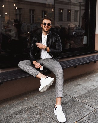 How to wear: white and black leather low top sneakers, black and white houndstooth chinos, white crew-neck t-shirt, black leather biker jacket