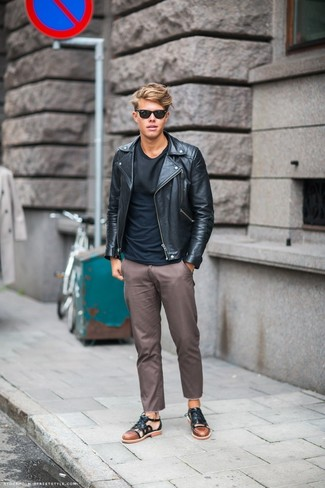 How to Wear a Black Leather Biker Jacket For Men: If the setting permits a casual look, you can always rely on a black leather biker jacket and brown chinos. For something more on the daring side to complete this getup, complete this look with a pair of black leather sandals.