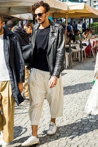 How to Wear a Black Leather Biker Jacket For Men: To achieve a laid-back ensemble with a modern take, wear a black leather biker jacket with white vertical striped chinos. If in doubt as to what to wear when it comes to shoes, go with a pair of white leather low top sneakers.