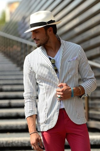 How to wear: white hat, red chinos, white crew-neck t-shirt, white vertical striped blazer