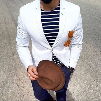 How to wear: brown wool hat, navy chinos, navy and white horizontal striped crew-neck t-shirt, white blazer