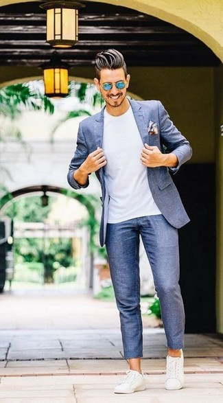 How to wear: white leather low top sneakers, blue chinos, white crew-neck t-shirt, blue blazer