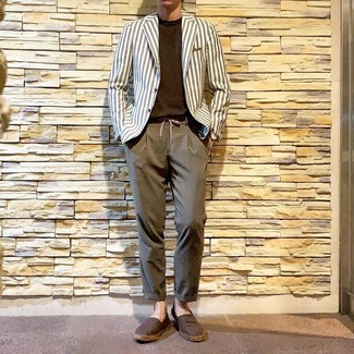How to Wear a White and Navy Vertical Striped Blazer For Men: We're loving the way this semi-casual combination of a white and navy vertical striped blazer and brown chinos immediately makes you look on-trend. Dress down this ensemble with brown canvas espadrilles.