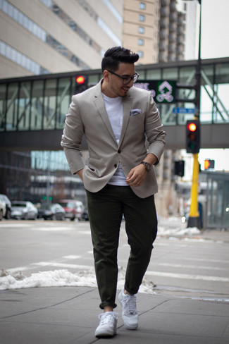 Men's Looks & Outfits: What To Wear In 2020: For an outfit that's casually neat and wow-worthy, try pairing a grey blazer with dark green chinos. Our favorite of a great number of ways to complete this outfit is white leather low top sneakers.