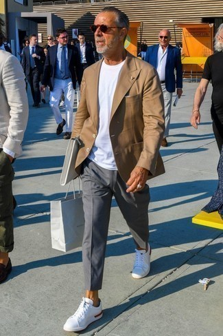 Fashion for Men Over 60: What To Wear: This pairing of a tan blazer and grey chinos is a safe option when you need to look sharp but have no time. White low top sneakers are guaranteed to bring a dose of stylish effortlessness to this look.