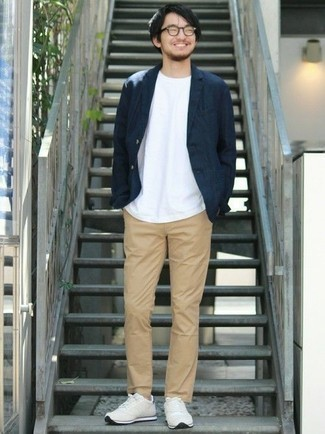Men's Looks & Outfits: What To Wear In 2020: This combination of a navy blazer and khaki chinos is uber versatile and provides instant class. For something more on the off-duty side to complement your getup, complete your ensemble with beige athletic shoes.