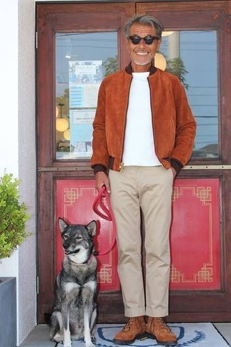 How to wear: brown suede high top sneakers, beige chinos, white crew-neck t-shirt, tobacco suede bomber jacket