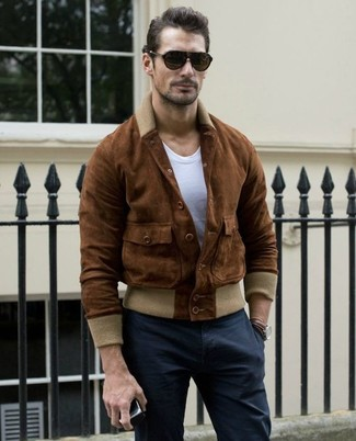 How to wear: dark brown sunglasses, black chinos, white crew-neck t-shirt, brown suede bomber jacket