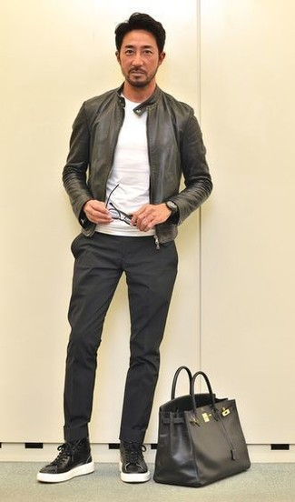 How to wear: black leather high top sneakers, black chinos, white crew-neck t-shirt, black leather bomber jacket