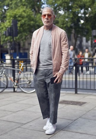 How to Wear Red Sunglasses For Men: A pink bomber jacket and red sunglasses married together are a nice match. If you want to easily kick up this outfit with one single piece, why not complete your look with white canvas low top sneakers?