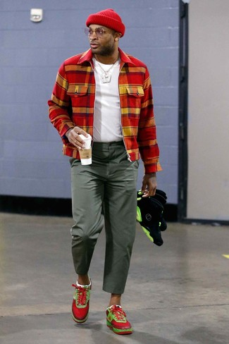 How to wear: red athletic shoes, olive chinos, white crew-neck t-shirt, red check bomber jacket
