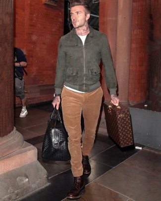 How to wear: dark brown leather casual boots, tobacco corduroy chinos, white crew-neck t-shirt, charcoal suede bomber jacket