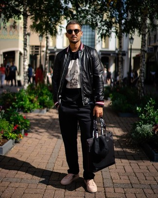 How to wear: white print leather low top sneakers, black chinos, black and white print crew-neck t-shirt, black leather bomber jacket