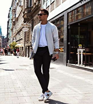 How to wear: white print leather low top sneakers, black chinos, white crew-neck t-shirt, grey bomber jacket