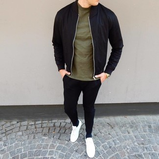 How to wear: white low top sneakers, black chinos, olive crew-neck t-shirt, black bomber jacket