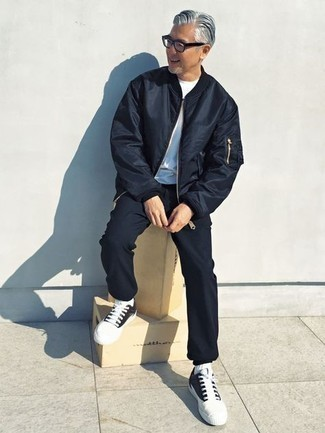 Men's Looks & Outfits: What To Wear In 2020: This pairing of a navy bomber jacket and navy chinos is proof that a straightforward casual outfit doesn't have to be boring. Finishing off with a pair of black and white canvas low top sneakers is a guaranteed way to introduce an easy-going touch to your getup.