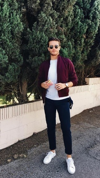 How to Wear a Burgundy Bomber Jacket For Men: Go for a burgundy bomber jacket and navy chinos to pull together an interesting and current casual ensemble. For something more on the casually cool side to finish this ensemble, introduce a pair of white leather low top sneakers to this getup.