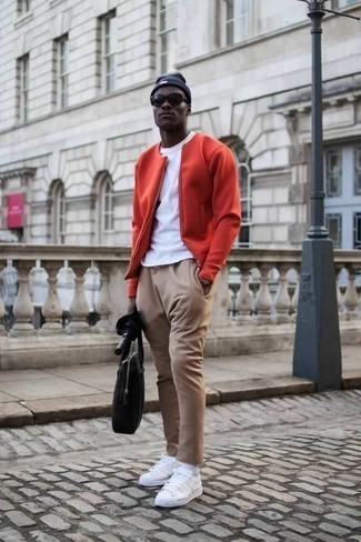 How to Wear a Black Canvas Tote Bag For Men: Go for a red bomber jacket and a black canvas tote bag to pull together an extra dapper and city casual outfit. Complete your outfit with white canvas low top sneakers to make the ensemble slightly smarter.