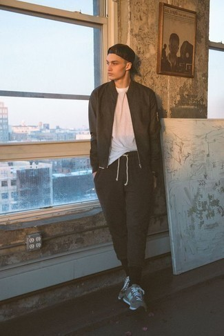 How to Wear a Black Watch For Men: Opt for a dark brown bomber jacket and a black watch to feel infinitely confident and look fashionable. Complement this ensemble with a pair of grey athletic shoes and ta-da: this outfit is complete.