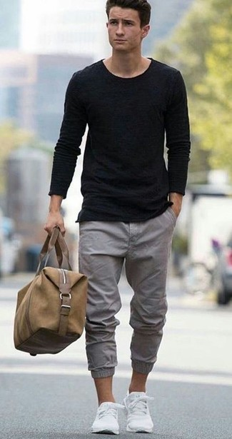 How to wear: white low top sneakers, grey chinos, black crew-neck t-shirt, black crew-neck sweater